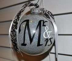 "As shown- color, font, and all date 7-10-13  Mr. & Mrs. Glittered Ornaments Wedding Bride and Groom Set with Date, 4"" Ribbon Bow Glass Ball Custom Personalized. $12.99, via Etsy."