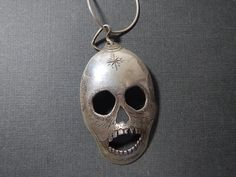 Day of the Dead skull and heart pendant by DBenoitArt on Etsy Recycled Silverware, Silverware Art, Cutlery, Unusual Jewelry, Handmade Jewelry, Sugar Skull Jewelry, Fork Art, Day Of The Dead Skull, Upcycling Ideas