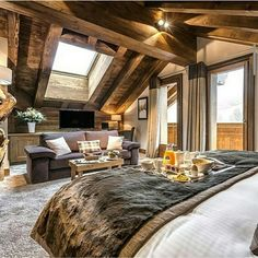 cozy cabin style bedroom | it's all about that faux fur and exposed wood