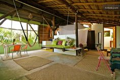 House in Tulum, Mexico. This tree top apartment is on the 3rd level of a wooden palapa and is nearly open to the jungle.  Surrounded by screens, with minimal walls, you will see the green parrots and caribbean blue jays pass in the morning as you sip your coffee.  Wander...