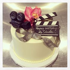 This cake is ready for a close up!! We hope this budding actress loves her pink orchids as much as we do. Happy birthday! Photo by Sugar Flower Cake Shop. www.sugarflowercakeshop.com
