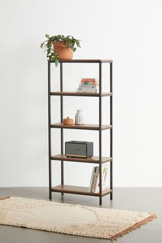 """Industrial-cool bookshelf with five tiers for storing your favorite reads, plants, ceramics and trinkets with a minimalist construction that puts the focus on your favorite things. Open on all sides, it features a metal frame with manufactured wood shelves. Assembly required.Content + Care. Assembly required instructions and hardware included Manufactured wood, metal Wipe clean Imported Size. Dimensions: 23.47""""l x 11.58""""w x 56.77""""h Shelf dimensions: 21.88""""l x 9.63""""w x 11.75""""h Top weight limit: 2 Tall Bookshelves, Wood Shelves, Shelving, Shadow Tree, Beautiful Living Rooms, Cleaning Wipes, Small Spaces, Living Spaces"""