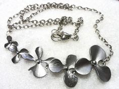 Strand of Flowers Necklace! Only $14! thenchantedforest.ca Enchanted, Bracelets, Shop, Flowers, Silver, Gifts, Jewelry, Presents, Jewlery
