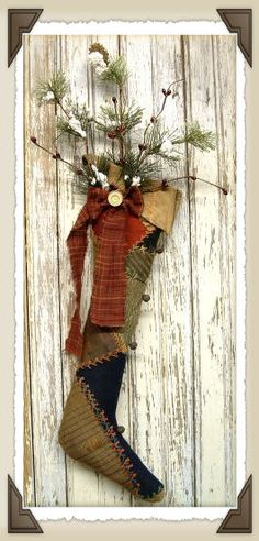 primitive stocking-- close up - look at the little rusty jingle bells!