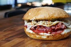 West Des Moines restaurant Smash Park is challenging Iowans to a Big Blue Food Challenge — featuring a five-pound Italian Meat Sandwich. The $39 sandwich is stacked high with salami, mozzerella, mortadella, ham, provolone and mozzarella, and if you can finish it, the sandwich is free, as is a T-shirt touting your accomplishment. Des Moines Restaurants, Mozzerella, Italian Meats, Meat Sandwich, Blue Food, Food Challenge, Hamburger, Sandwiches, Canning