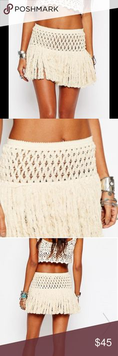 """Crochet Beach Skirt This adorable skirt is perfect to throw on over your suit. It's made from a super soft and comfortable 100% cotton knit. Stretchy open weave waistband. Tassel fringing detail. Available in medium and large. Medium fits waist 28.5""""-39.5"""", hips 38.5""""-40.5"""". Large fits waist 32.5""""-35.5"""", hips 42.5""""-45.5"""". More pics and specs upon arrival. Swim Coverups"""