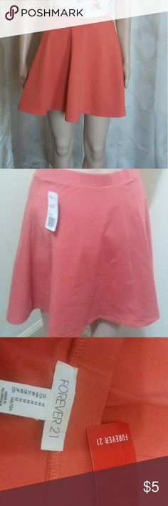"""Forever21 skirt pink skater skirt NWT Size medium Forever21 pink circle skirt with elastic waist and stretch.  New with tags. 95% cotton 5% spandex Waist 26"""" Length 16"""" Forever21 Skirts Circle & Skater"""
