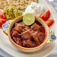 """If there is such a thing as Mexican soul food, this is it - carne con chile colorado, literally """"meat with red-colored chile sauce."""" For this year's Cinco de Mayo celebration, honor the true spirit..."""