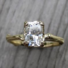 Oh gosh - this is seriously beautiful and would be an engagement ring I would wear everyday. I love the twig detail in the band!! And the fact that it's not a diamond ^_^ lol love love love this!