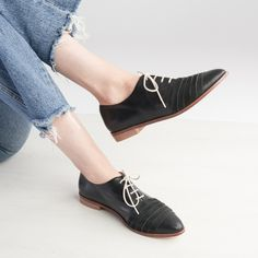 Borrow a little style from the boys this season with Mila black leather flats. The pair has an elegant point-toe shape with nubuck panel keeping them ladylike Black Leather Flats, Black Flats, Leather Design, Vegetable Tanned Leather, Toe Shape, Oxford Shoes, Pairs, Elegant, Fashion