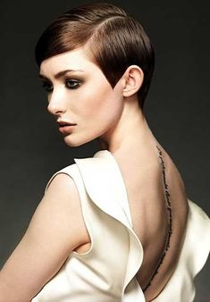 Streamlined and slicked short Hairstyle. And I love her tattoo.