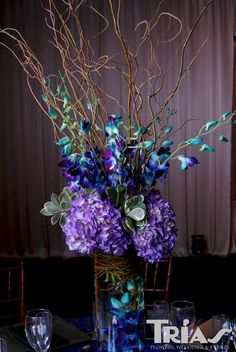 Purple centerpiece accented with blue. Beta Fish Centerpiece, Tall Centerpiece, Centerpiece Ideas, Blue Orchid Centerpieces, Peacock Wedding Centerpieces, Purple Wedding, Wedding Flowers, Dream Wedding, Wedding Cake