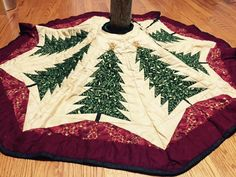 Quilted tree skirt, quilted  Christmas tree skirt, Christmas tree patchwork tree skirt in red green and gold with golden metal clasps by DowneastTraditions on Etsy https://www.etsy.com/listing/239056956/quilted-tree-skirt-quilted-christmas