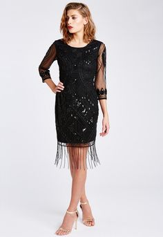 Taking inspiration from the opulent 1920's flapper era, the Clara dress is exquistely embellished with shimmering beads and sequins for a truly dazzling look! With half length sheer sleeves and a contemporary shift silhouette that skims over curves, this chic LBD is extremely flattering and will ensure you feel every inch as good as you look. Limited edition Shift dress fit Beaded fringe hem Sheer mesh sleeves Knee-length - shoulder to hem (excluding fringing): 92cm Also available in black…
