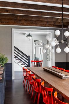 Eclectic modern farmhouse with unexpected pops of color in New York Crisp Architects along with Change & Co. designed this eclectic modern farmhouse as a weekend retreat for a young family in upstate New York. Dining Room Design, Dining Area, Dining Rooms, Red Dining Chairs, Dinner Chairs, Rattan Chairs, Hanging Chairs, Design Room, Co Design