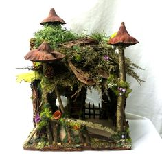 Forest Whimsy fairy house with little garden pots waiting for a fairy or gnome gardener. Contact: forstwim@sonic.net