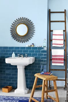 Subway tile halfway up the wall makes a statement, especially when the grout matches the painted wall above. Laticrete Twilight Blue Epoxy Powder Grout, about $15 for a 2¼-pound carton; Lowe's
