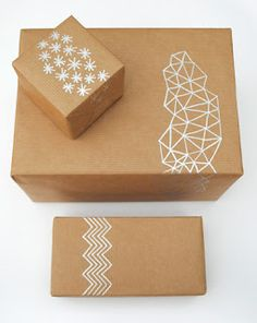 use silver sharpie to make your own wrapping paper