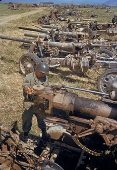 A U.S. soldier inspects captured German artillery at Tunisia, 1943.