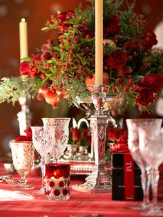 The classic centerpiece is composed of mixed evergreens with holiday-red fruit, flowers, and berries.