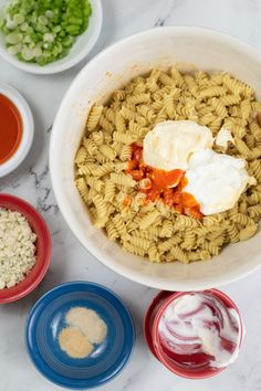 A creamy cool dressing, hot buffalo sauce, tangy blue cheese, flavorful chicken, and pasta are all mixed together in this yummy take on our favorite party food but in an easier to eat format. Perfect for picnics, potlucks, and packing for your lunch! Chicken Wing Flavors, Chicken Salad Recipes, Buffalo Chicken Pasta Salad, Healthy Pastas, Potlucks, Blue Cheese, Picnics, Good Food, Food And Drink
