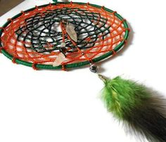 This dreamcatcher is hand woven using pumpkin orange and dark green seed beads in a tight weave.  #zibbet