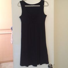 Sleeveless Black Baby Doll Dress This dress is a great layering piece or beautiful worn alone. Well loved and cared for with price reduced to account for wear. Average wear under arms. Saint Tropez West Dresses Strapless