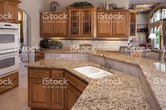 Custom Luxury Eat-In Kitchen With Granite Counters, Oak Cabinets royalty-free stock photo