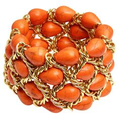Gold-plated chain link bracelet with four strands of teardrop-shaped coral turquoise stones.  Product: BraceletConst...