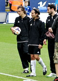 Louis and Harry when they're at niall's charity football match