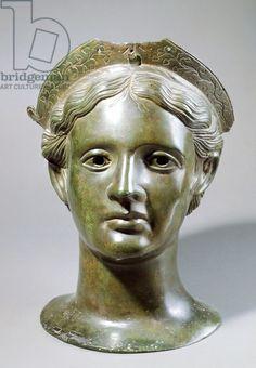 Bronze head of a god. Etruscan civilization, 300-250 BC. Artwork-location: Paris, Musée Du Louvre