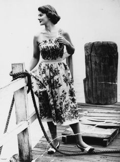 Strapless dress being modelled on a young woman at North Quay, Brisbane, ca. 1951