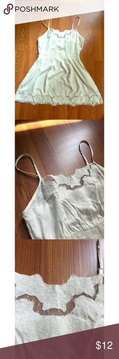 Lace tank top Delicate and feminine lace tank top. In excellent condition overall, has tiny black dot on back below the waist. Twenty One Tops Camisoles