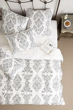Carapelle Duvet #anthropologie - Throw in some fun colorful throw pillows which you can change every season!  This with the canopy bed