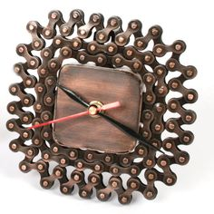 £16.00 Clever stuff from Fair Trade artisans in India!  This clock has been handmade from recycled bike chains and spare parts.    Take a closer look... http://www.thefairtradestore.co.uk/fair-trade-homeware/other-craft-products/recycled-bike-chain-clock/prod_526.html   #Fairtrade #Eco #Handmade #Recycled #Clock