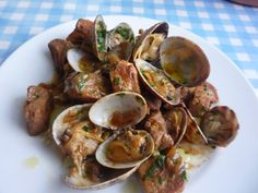 Carne de Porco à Alentejana. one of the most traditional and popular pork dishes of Portuguese cuisine. It is typical from the Alentejo region, in Portugal, hence the word Alentejana (from Alentejo) in its name. It is a combination of pork and clams, with potatoes and coriander.