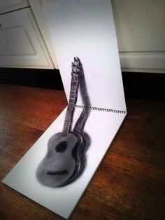 Drawings - Dutch artist Ramon Bruin uses nothing but paper, pen, and cleverly positioned props, to create the illusion of depth. He calls the technique 'anamorphosis', but refuses to explain exactly how it's done. Guitar Sketch, Guitar Drawing, 3d Pencil Drawings, Cool Drawings, Amazing Drawings, Pencil Art, 3d Sketch, Sketches, Realistic Sketch