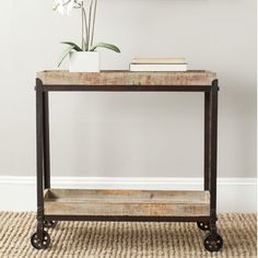 Safavieh Safavieh Sally Rolling Console Table, $183 from Wayfair for project storage
