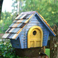 Blue birdhouse with yellow door