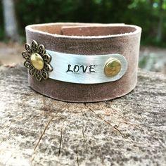 "Handcrafted leather ""love"" cuff bracelet by WildArrowStudio on Etsy https://www.etsy.com/listing/235324628/handcrafted-leather-love-cuff-bracelet"