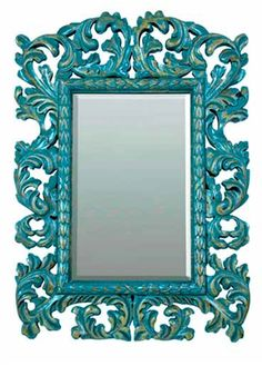 hard carved Baroque Acanthus  mirror.  This is a great way to add a splash of Turquoise/Aqua/Teal color to any room