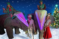 Christmas themed life size elephant stilts to hire with LED and riding Christmas elves. Large scale stilts to hire across the UK Father Christmas, Christmas Elf, Christmas Themes, Close Encounters, Walkabout, Gentle Giant, Party Entertainment, Corporate Events