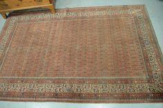 "Oriental area rug.  5' x 7'9""  Provenance:  The Estate of Natalie Rafferty  Estimate: $200 - $300"