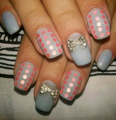 Simple Elegant polka dot nails with charm. Cute and classy