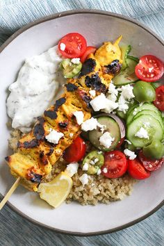 Smoky yogurt-marinated grilled chicken served over quinoa and Mediterranean-inspired tomatoes, cucumbers, and olives with tzatziki and Feta.