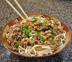 Udon noodles topped with luscious ground pork, simmered in a peppery sauce with tahini