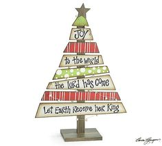 """Wood plank Christmas tree with """"Joy To The World"""" message, accented by distressed wood star and bells on wire around the tree. 18 1/2"""" H x 12 3/4"""" W x 5"""" D. *Ch"""