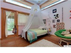 """Of the four total, this is one of the two """"main bedrooms."""""""