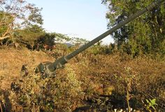 Aircraft gun poking out of the undergrowth Muang Phin Southern Laos along old RT 23 Ho Chi Minh trail