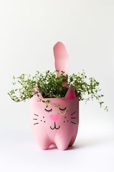 an empty soda bottle into an adorable kitty plant planter for catnip, herbs. - SALTY CANARY / Pins - Turn an empty soda bottle into an adorable kitty plant planter for catnip, herbs. Reuse Plastic Bottles, Plastic Bottle Crafts, Soda Bottle Crafts, Recycled Bottles, Diy And Crafts, Crafts For Kids, Cute Diy Projects, Soda Bottles, Diy Planters